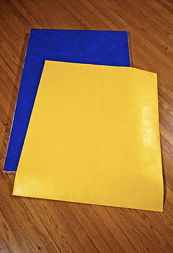 Yellow paper dropped on Blue canvas
